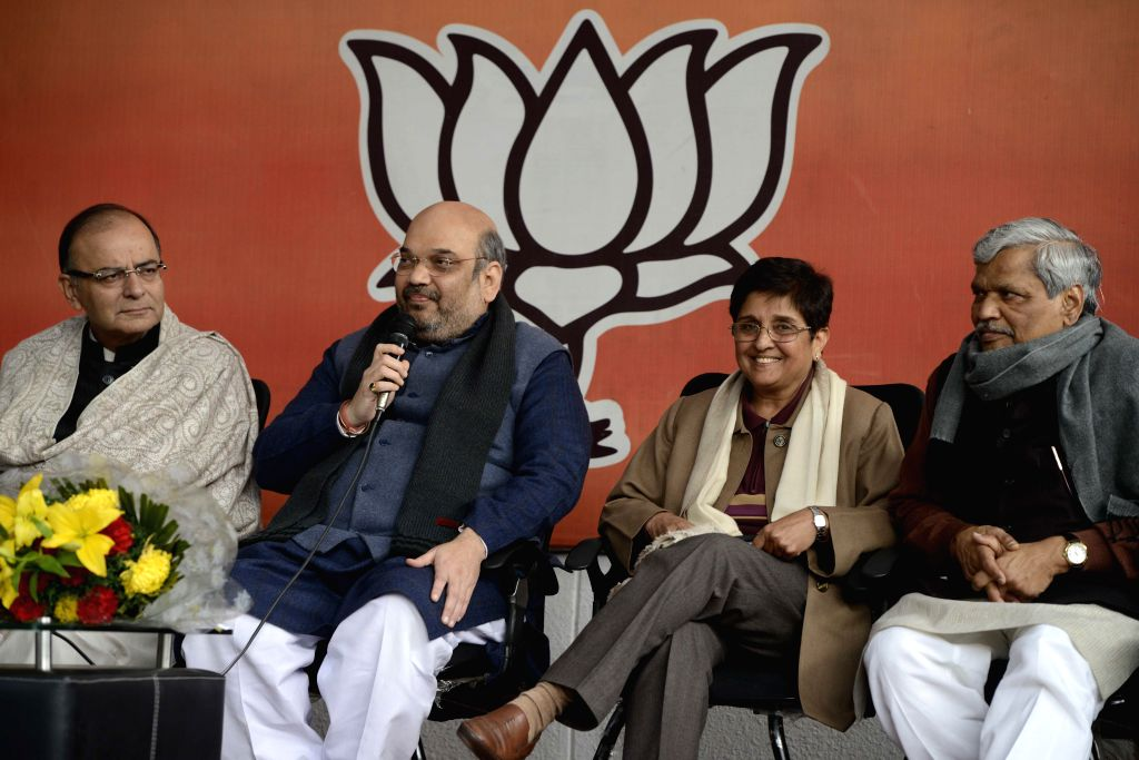 (L-R) Union Minister for Finance, Corporate Affairs, and Information and Broadcasting Arun Jaitley, BJP chief Amit Shah, social activist Kiran Bedi and Delhi in-charge of the party ... - Arun Jaitley and Amit Shah