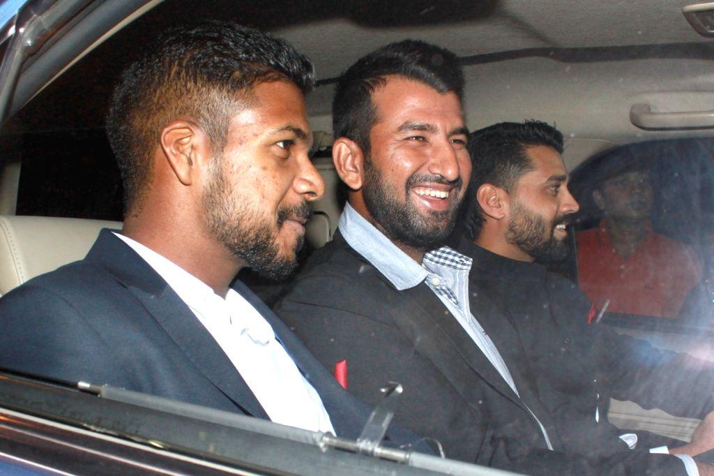 New Delhi:(L to R) Cricketer Varun Aaron, Cheteshwar Pujara and Murali Vijay arrives to attend the wedding reception of cricketer Harbhajan Singh and actress Geeta Basra in New Delhi, on Nov 1, 2015.