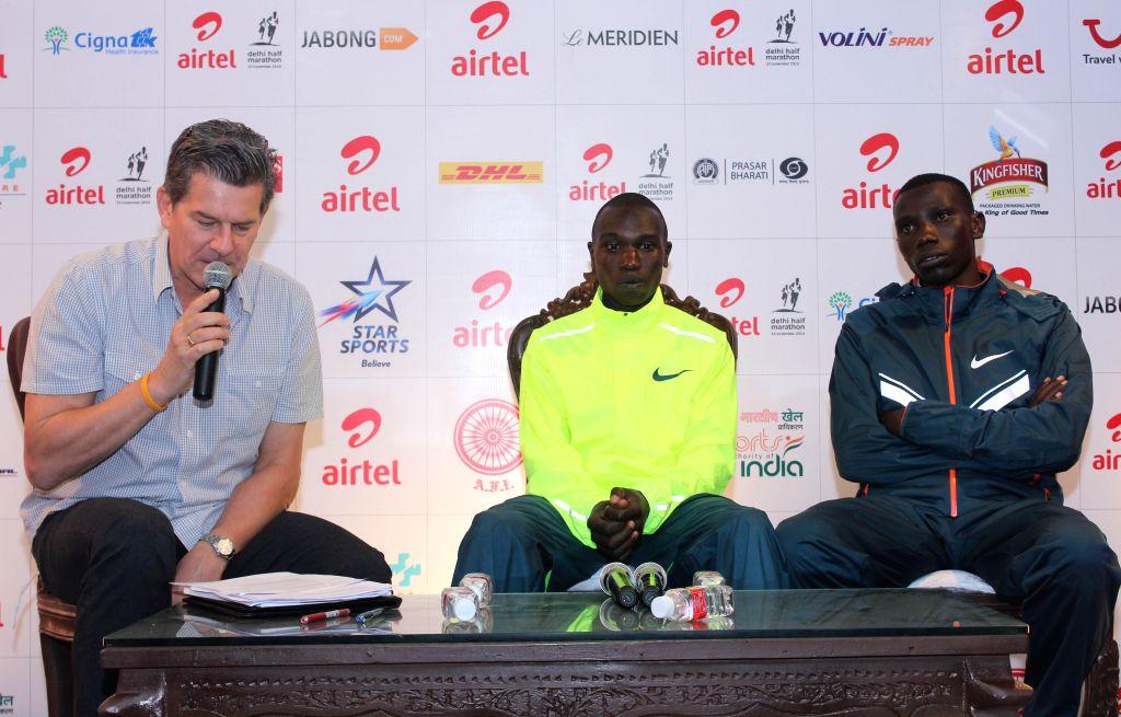 (L to R) Kenya`s marathon runners Geoffrey Kamworor and Abraham Cheroben during a press conference of Airtel Delhi Half Marathon organised by pocram in Nehru stadium in New Delhi on Nov. ..