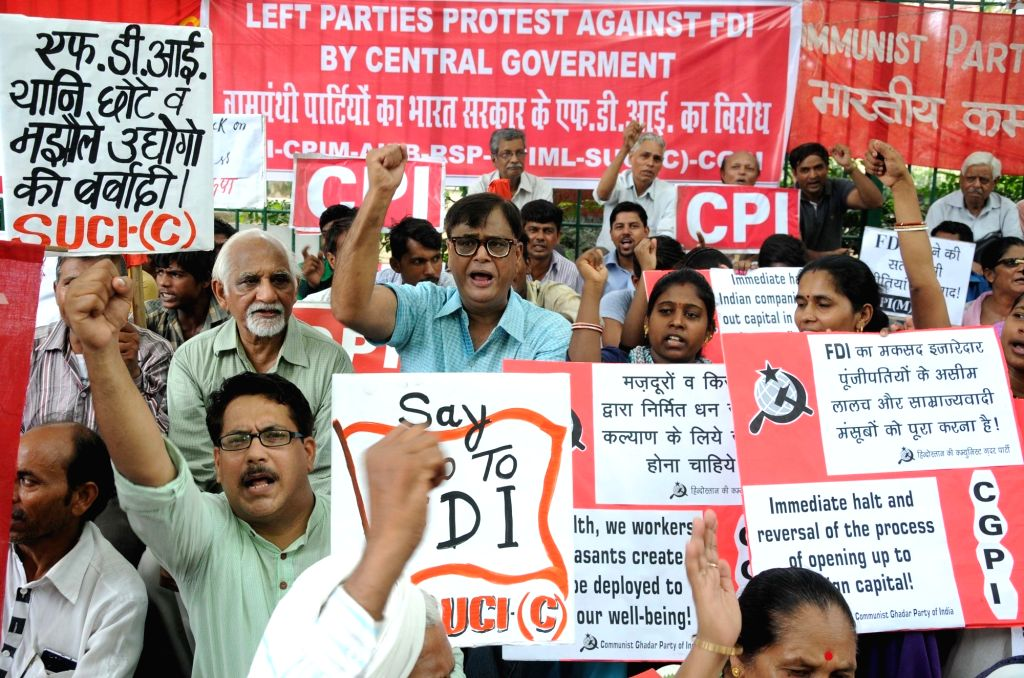 New Delhi: Left parties stage a demonstration against FDI at Jantar Mantar in New Delhi on June 26, 2016. Seven left parties including CPI, CPI-M , Forward BlocK, RSP, CPI-ML, SUCI (C), ...