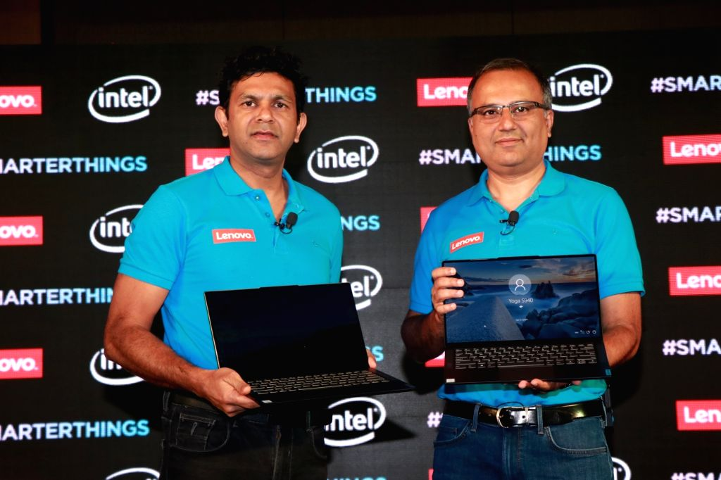 "New Delhi: Lenovo India MD and CEO Rahul Agarwal and Lenovo's Executive Director and India PCSD Consumer Leader Shailendra Katyal unveil Lenovo's ultra-slim PC ""Yoga S940"" with Artificial intelligence (AI) and advanced audio and display technologies,"