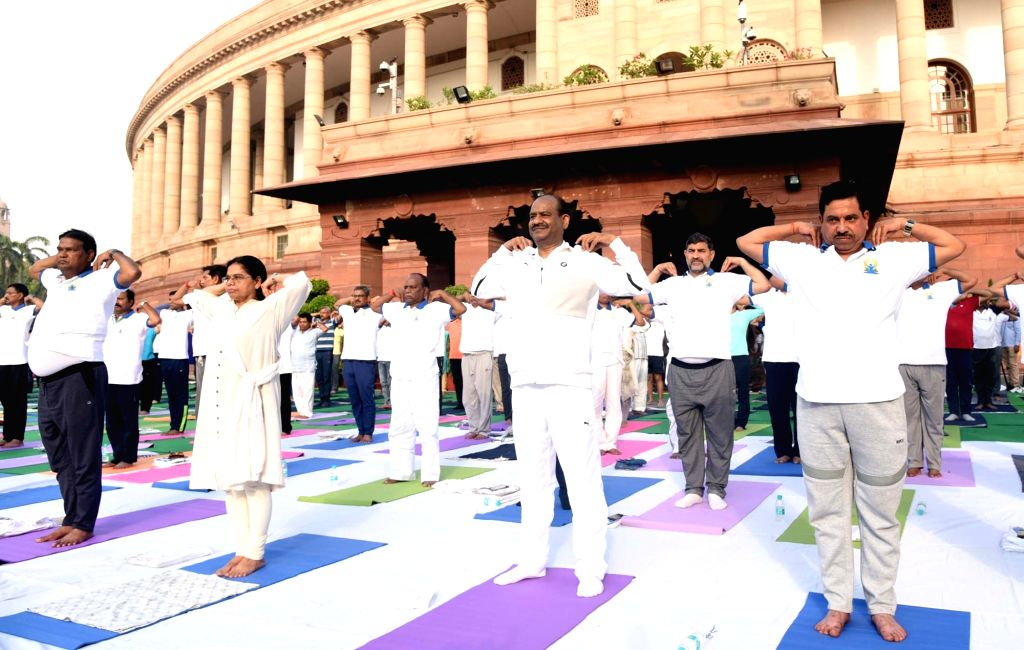 New Delhi: Lok Sabha Speaker Om Birla and BJP MP Bhupender Yadav practice yoga asanas -postures- on International Yoga Day 2019 at Parliament premises in New Delhi on June 21, 2019. (Photo: IANS) - O and Bhupender Yadav