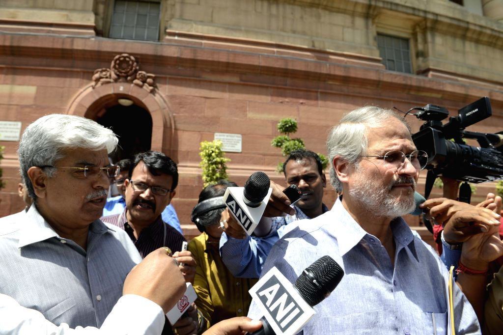 Lt. Governor of Delhi Najeeb Jung and Delhi Police Commissioner Bhim Sain Bassi after meeting Union Home Minister Rajnath Singh at Parliament House in New Delhi on April 23, 2015. - Rajnath Singh