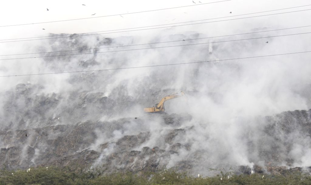 New Delhi: Major fire broke out at east Delhi's Ghazipur landfill, on Nov 25, 2020. Firefighting operations continued on Wednesday morning as toxic fumes from the burning garbage filled the air. No injuries were reported from the spot. The cause of t