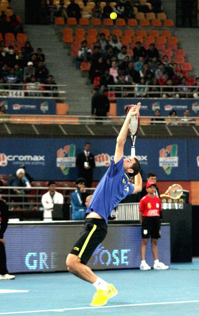 Marin Cilic of UAE Royals in action against Jo-Wilfried Tsonga of Manila Mavericks at Indira Gandhi Indoor Arena in New Delhi, on Dec 7, 2014. Cilic won. Score: 5-6.