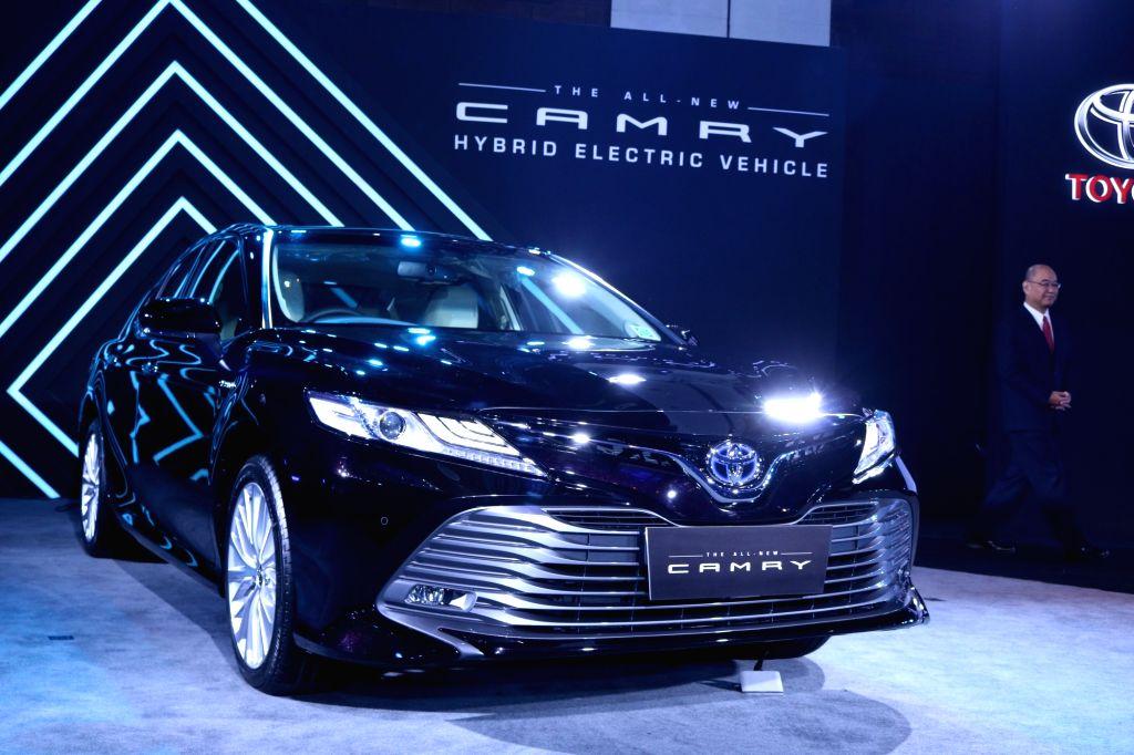 New Delhi: Masakazu Yoshimura, Managing Director of Toyota Kirloskar launches new Camry hybrid with other officials in New Delhi on Jan. 18, 2019. (Photo: IANS)