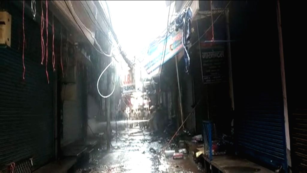 New Delhi: Massive fire breaks out at the Gandhi Nagar market in New Delhi, on Aug 13, 2019. A total of 21 fire tenders have been rushed to the spot. There were no reports of any injury yet. (Photo: IANS)