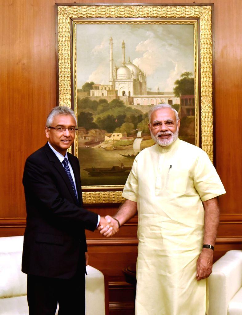 New Delhi: Mauritius Minister of Finance and Economic Development Pravind Kumar Jugnauth calls on Prime Minister Narendra Modi in New Delhi on Sept 15, 2016. - Narendra Modi