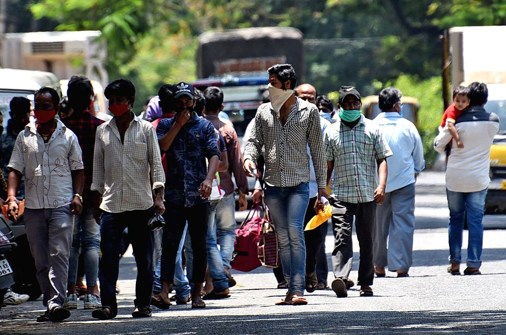 New Delhi, May 14 (IANS) Hiding during the day and walking over 20 km everynight has become a routine for Shiv Babu, 23, a textile factory worker, who like scores of migrant labourers around the country is desperately trying to reach his far-off vill