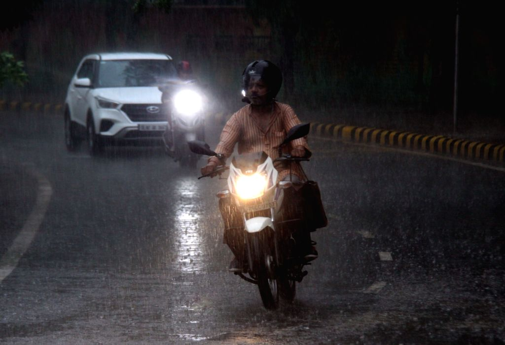 New Delhi, May 29 (IANS) Heavy rains lashed the national capital and neighbouring areas on Friday evening, bringing much-needed respite to the people reeling under intense heat. (File Photo: IANS)