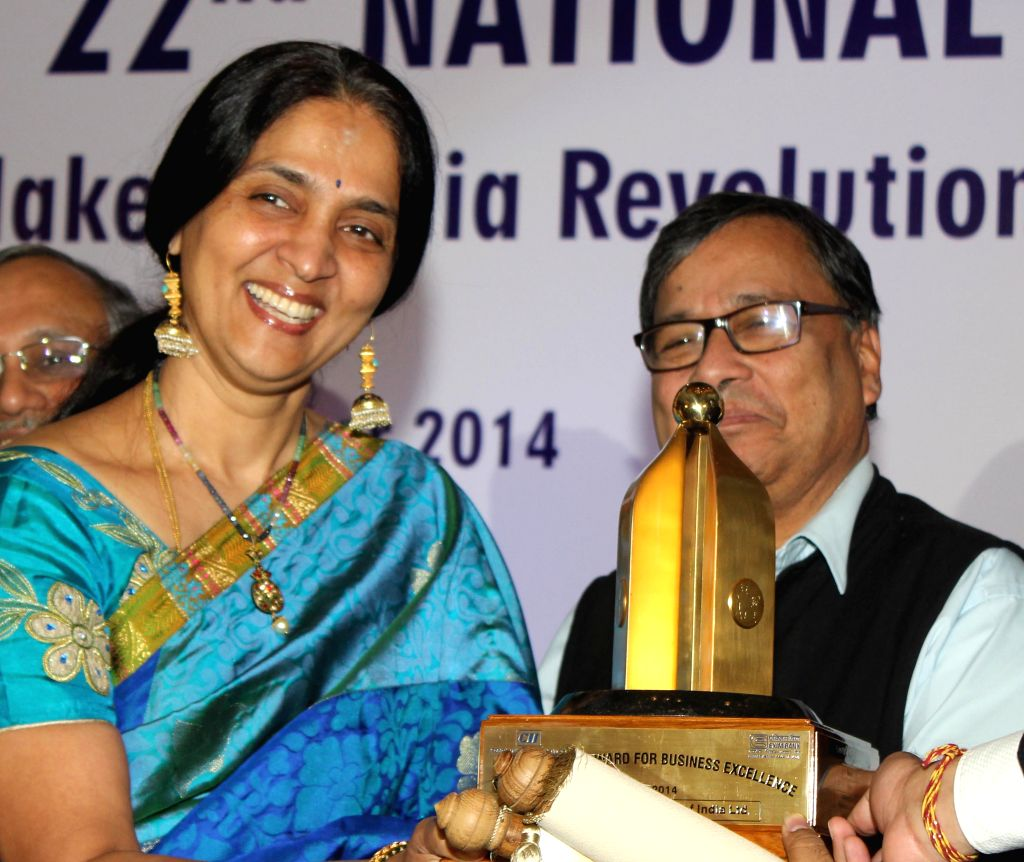 MD and CEO of NSE Chitra Ramkrishna receives CII EXIM Bank Business Excellence Award 2014 from Member Secretary of National Manufacturing Competitiveness Council Ajay Shankar during the ...