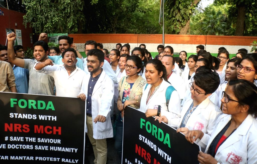 New Delhi: Medical students stage a demonstration against the recent attacks on doctors in Kolkata; in New Delhi on June 13, 2019. (Photo: IANS)