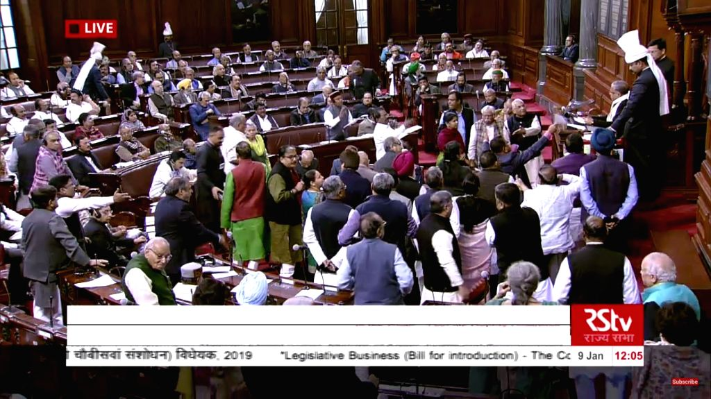 New Delhi: Members of the opposition parties gather in the well of Rajya Sabha to demand discussion on Citizenship (Amendment) Bill, on Jan 9, 2019. The Lok Sabha on Tuesday passed the Citizenship Amendment Bill, 2019 that seeks to remove hurdles in