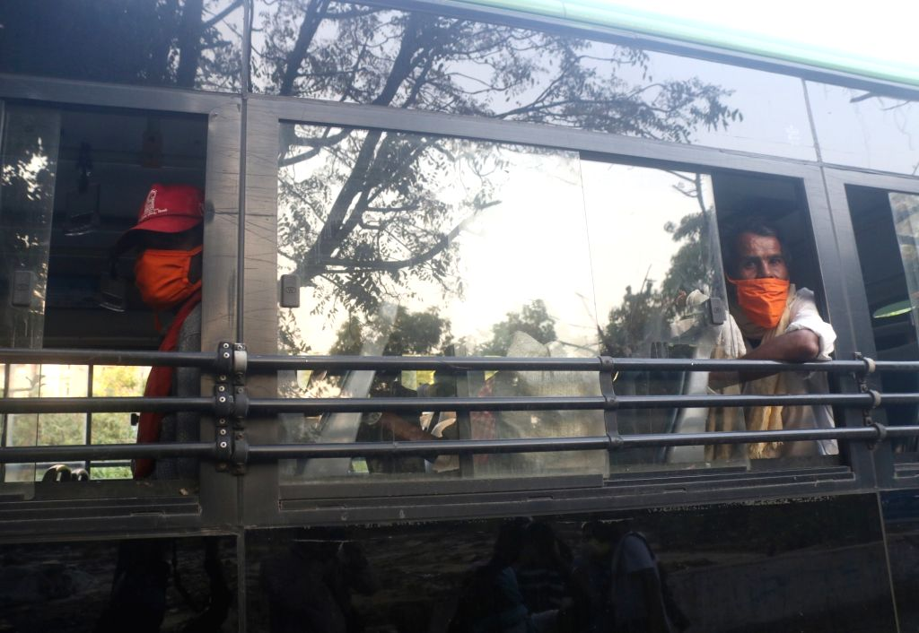 New Delhi: Migrant labourers from Madhya Pradesh who were stranded in Delhi due to the ongoing nationwide lockdown imposed to mitigate the spread of coronavirus, being transported to the New Delhi Railway Station from where they will return back home