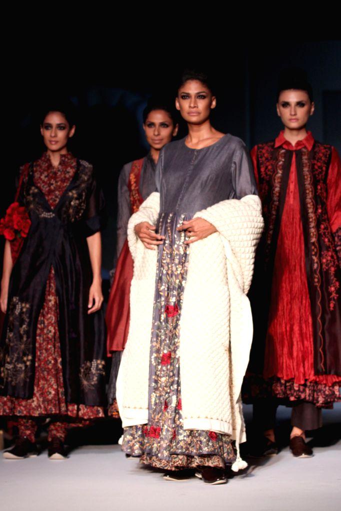 Models showcases fashion designer Pratima Pandey`s creations during Amazon India Fashion Week in New Delhi, on March 28, 2015.