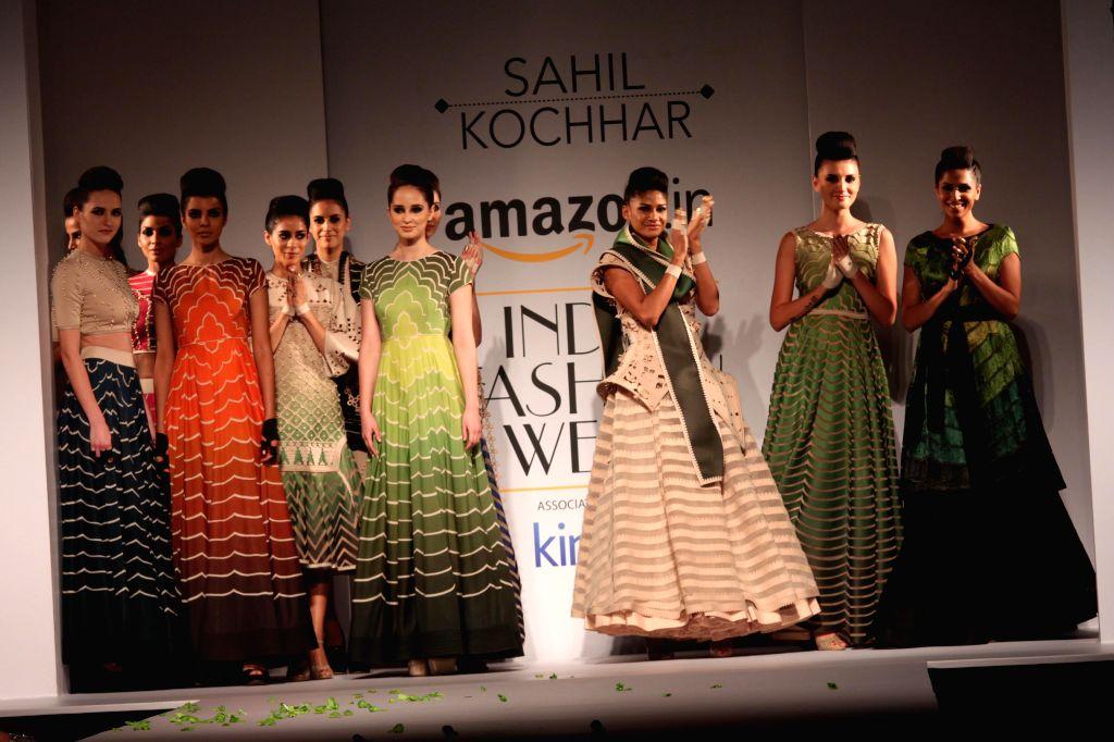 Models showcases fashion designer Sahil Kochhar`s creations during Amazon India Fashion Week in New Delhi, on March 28, 2015.