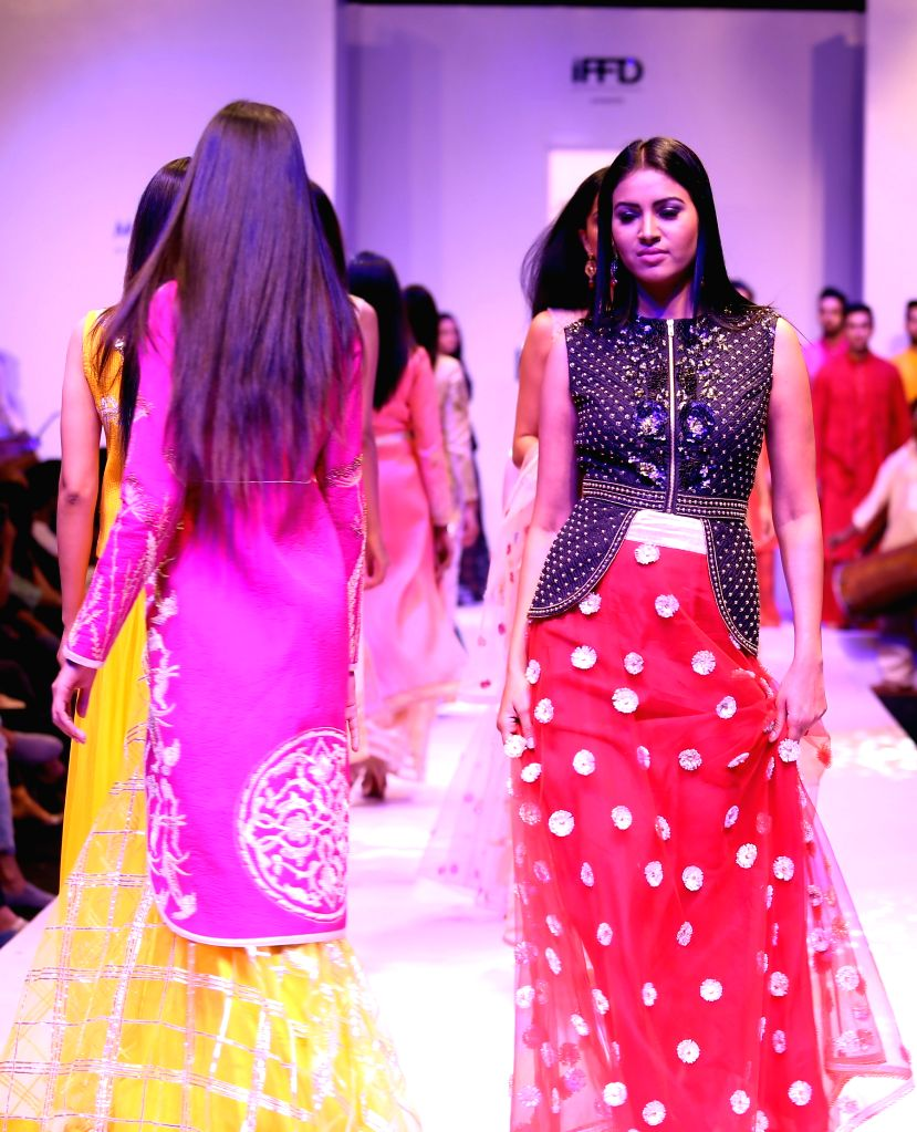 Models walk the ramp for fashion designer Jenjum Gadi during the fourth season of the India Runway Week, Spring Summer Collection - 2015 in New Delhi, on April 10, 2015.