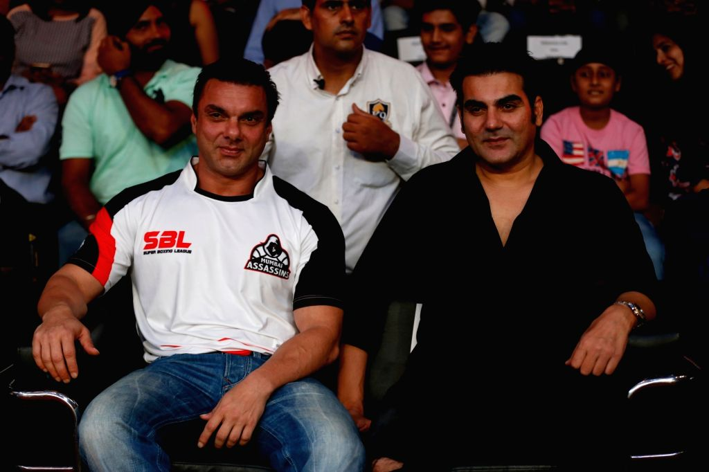 New Delhi: Mumbai Assasins co-owner and actor Sohail Khan along with brother Arbaaz Khan during the Grand Finale of Super Boxing League at DDA Squash and Badminton Stadium in New Delhi on ... - Sohail Khan and Arbaaz Khan