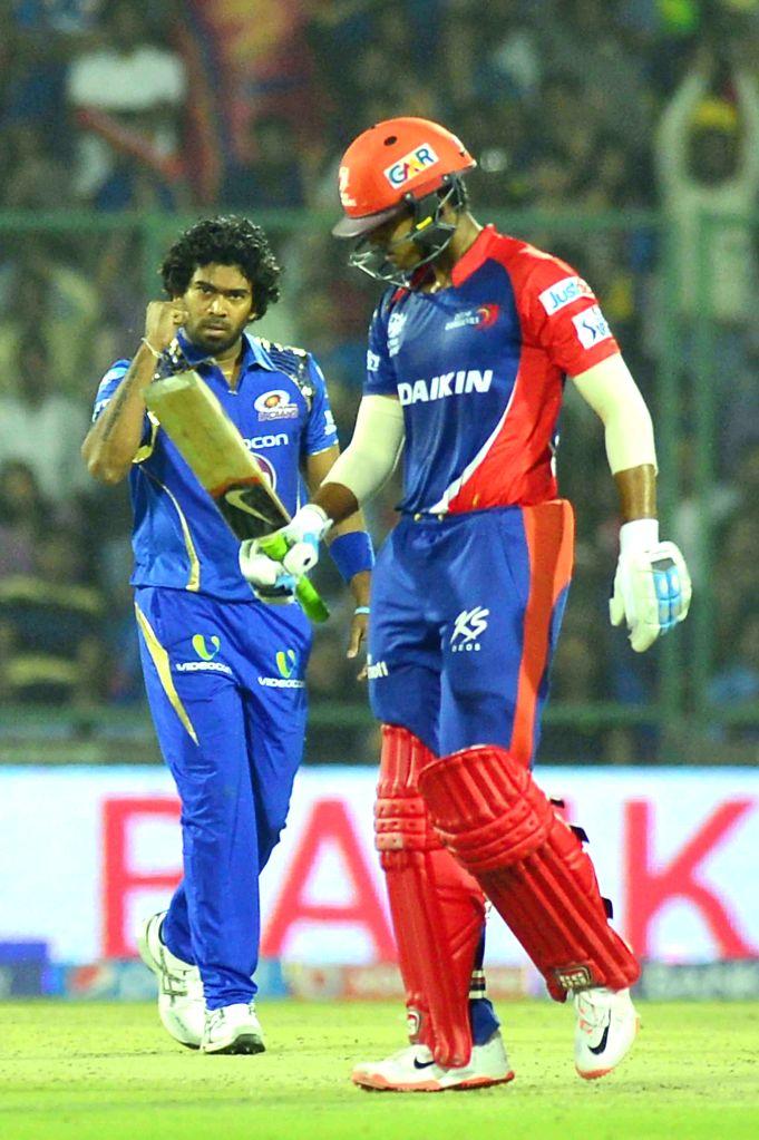 Mumbai Indians bowler Lasith Malinga celebrates fall of  Shreyas Iyer's wicket during an IPL-2015 match between Delhi Daredevils and Mumbai Indians at Feroz Shah Kotla stadium, in New ... - Lasith Malinga and Feroz Shah Kotla