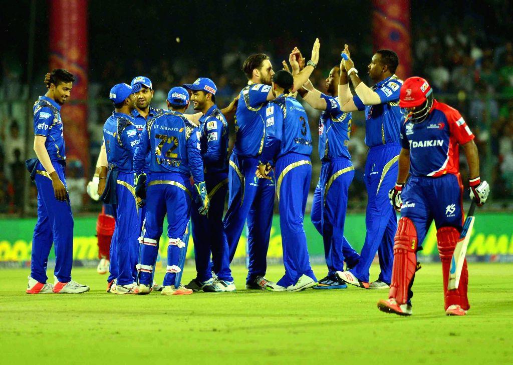 Mumbai Indians celebrate fall of a wicket during an IPL-2015 match between Delhi Daredevils and Mumbai Indians at Feroz Shah Kotla stadium, in New Delhi, on April 23, 2015. - Feroz Shah Kotla