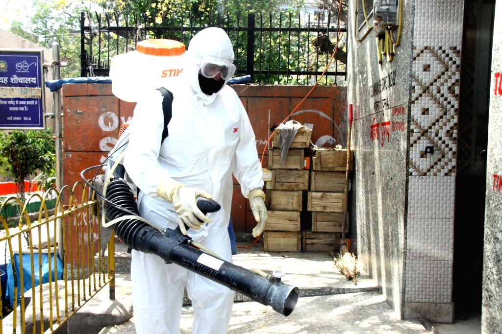 New Delhi: Municipal workers spray disinfectants to sanitise Delhi's Nizamuddin area where 24 cases of positive coronovirus were detected till Tuesday late night, during the 21-day nationwide lockdown (that entered its 8th day) imposed as a precautio