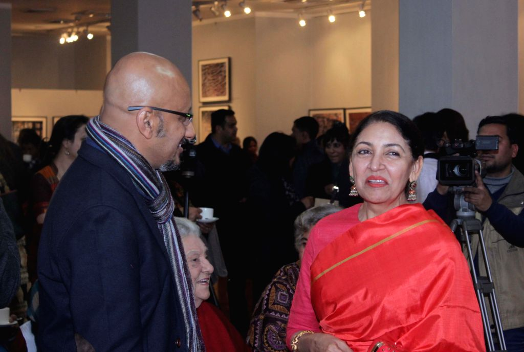Music director Shantanu Moitra and actress Deepti Naval at Kishore Thukral's photography exhibition in New Delhi, on Jan 14, 2015.