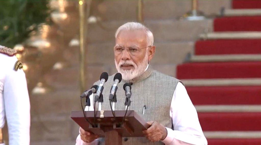 New Delhi: Narendra Modi takes oath as the Prime Minister of India for the second consecutive term at a swearing-in ceremony at Rashtrapati Bhavan in New Delhi on May 30, 2019. (Photo: IANS) - Narendra Modi