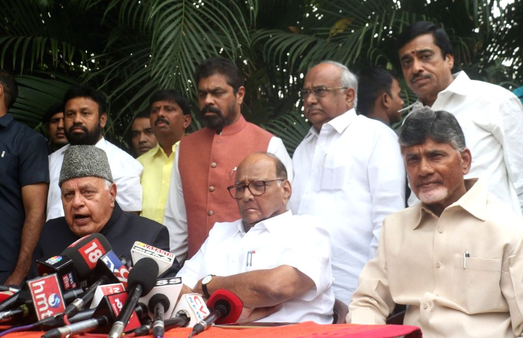 : New Delhi: National Conference president Farooq Abdullah accompanied by Andhra Pradesh Chief Minister and Telugu Desam Party (TDP) chief N. Chandrababu Naidu and NCP chief Sharad Pawar during a ...