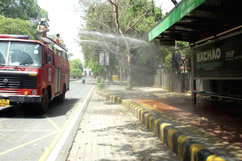 New Delhi: NDMC firefighters spray disinfectants at government residentials flats during the nationwide lockdown imposed to mitigate the spread of COVID-19 pandemic, in New Delhi on Apr 15, 2020. (Photo: IANS)