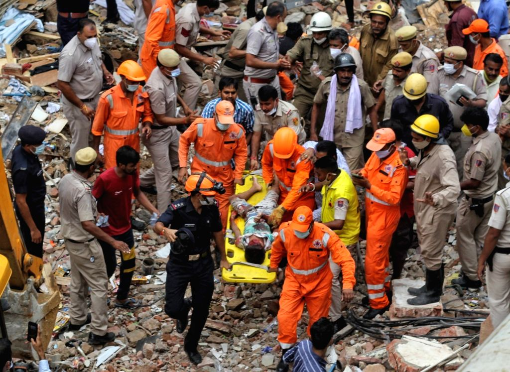 New Delhi : NDRF and Delhi Police personnel carried out a rescue operation after a four-storey building collapsed in Sabzi Mandi area, the main market in New Delhi on Monday September 13, 2021. (Photo: Wasim Sarvar/IANS)