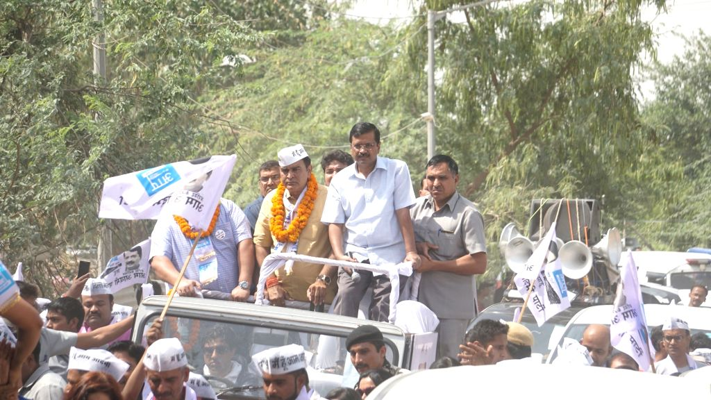 New Delhi: New Delhi: AAP's candidate from West Delhi, Balbir Singh Jakhar accompanied by Delhi Chief Minister Arvind Kejriwal, during a road show for the forthcoming Lok Sabha polls, in New Delhi, on May 8, 2019. (Photo: IANS) - Arvind Kejriwal and Balbir Singh Jakhar