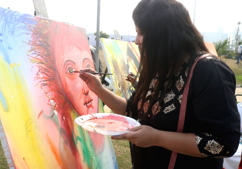 """New Delhi: New Delhi: An artist during """"Menstrual Health and Awareness Day"""" programme organised by Delhi government in New Delhi, on Feb 5, 2019. (Photo: IANS)"""