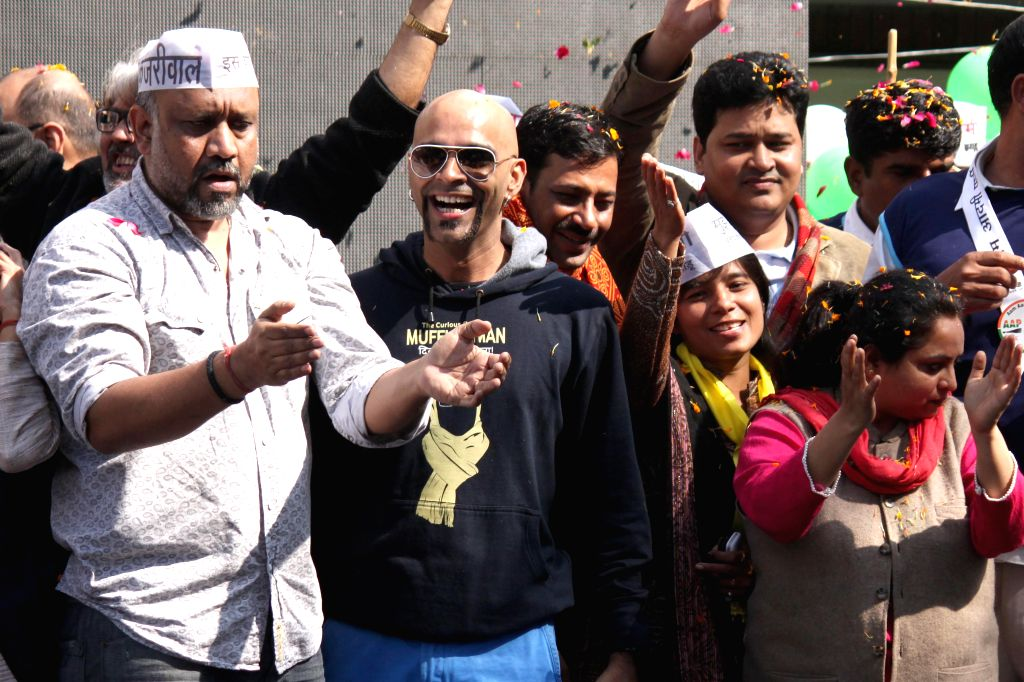 New Delhi: Producer Raghu Ram celebrates Aam Aadmi Party (AAP) party`s victory in the recently concluded Delhi Assembly Polls in New Delhi, on Feb 10, 2015.