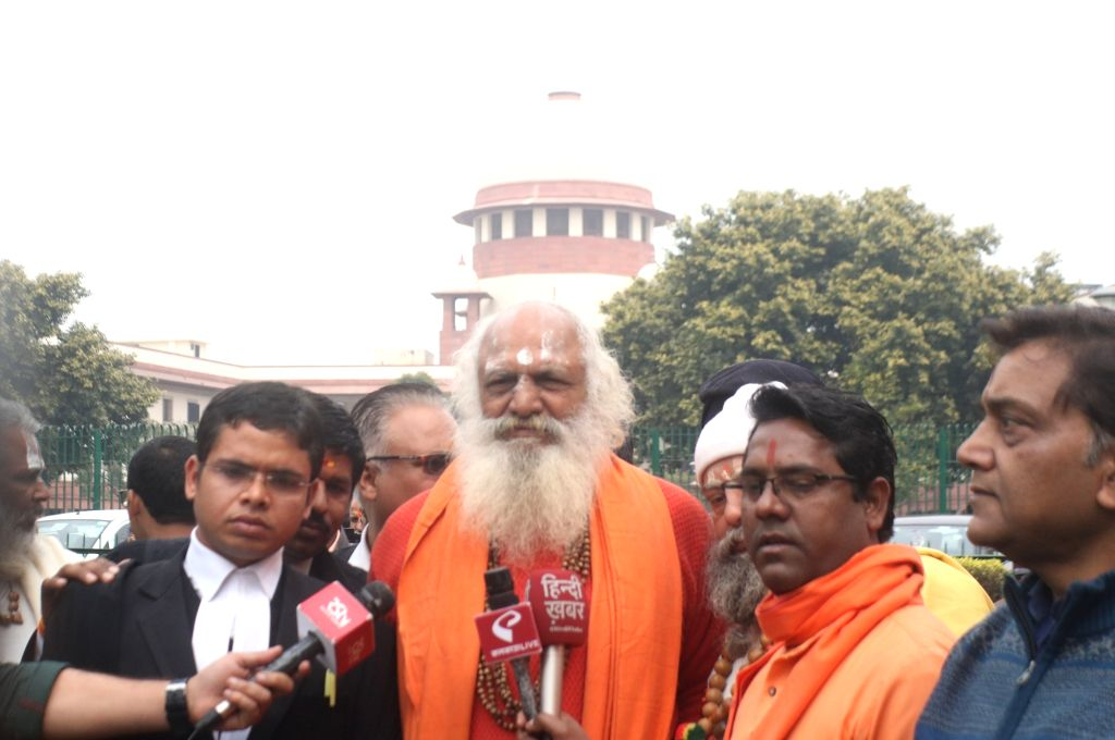 New Delhi: Nirmohi Akhara Mahant Dharam Dass, one of the petitioner of Ram Janambhoomi -Babri Masjid title suit along with other members and lawyers addresses media at Supreme Court in New Delhi on Feb 26, 2019. The Supreme Court (SC) on Tuesday said