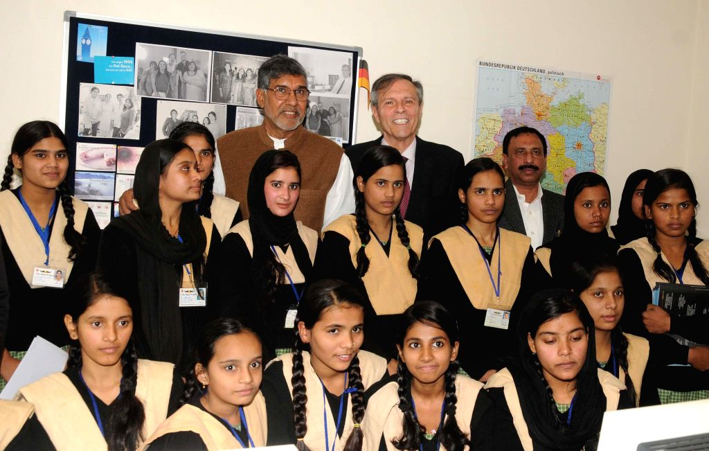 Nobel laureate Kailash Satyarthi and the German Ambassador to India Michael Steiner with school students during a programme at the German Embassy in New Delhi, on Dec 18, 2014.