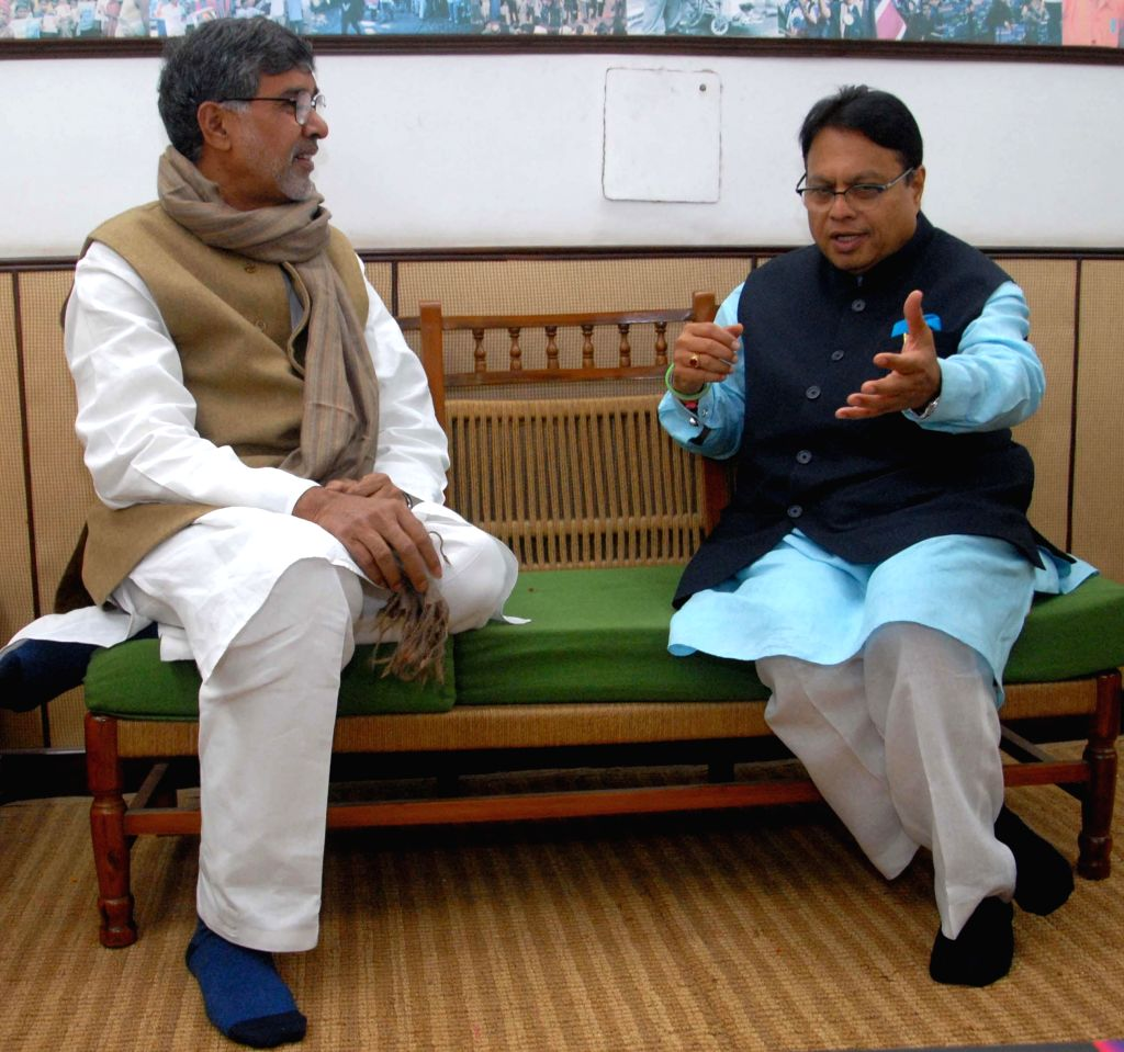 Nobel laureate Kailash Satyarthi and Congress leader Vijay J. Darda during a programme organised to launch `Public Issues Before Parliament` - a book, in New Delhi, on Dec 23, 2014.