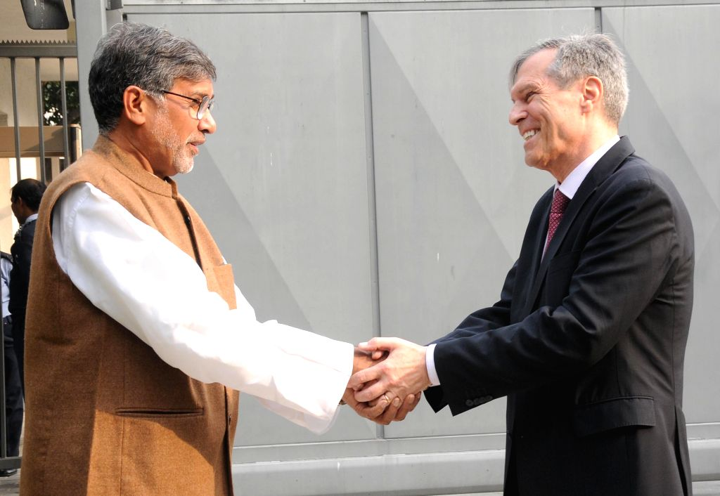 Nobel laureate Kailash Satyarthi with the German Ambassador to India Michael Steiner during a programme at the German Embassy in New Delhi, on Dec 18, 2014.