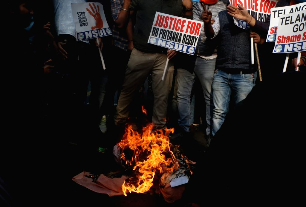 New Delhi: NSUI activists stage a demonstration against Telangana Government over the gruesome gang rape and murder of a woman veterinarian in Hyderabad; in New Delhi on Nov 30, 2019. (Photo: IANS)