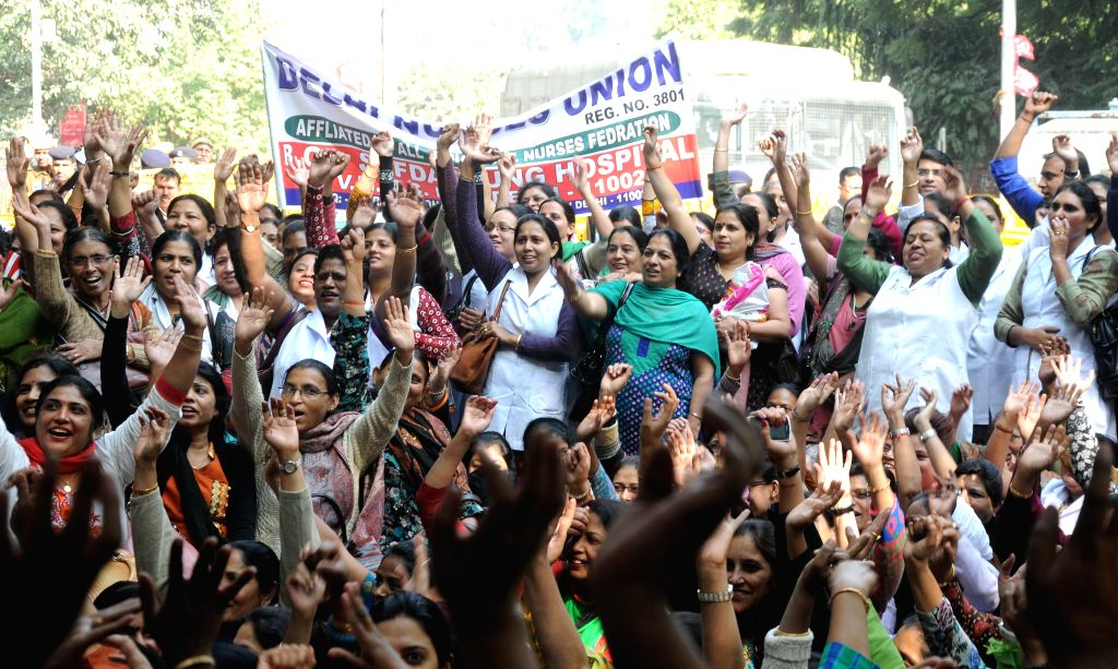 Nurses stage a demonstration against certain health policies of the government at Jantar Mantar in New Delhi, on Nov 26, 2014.