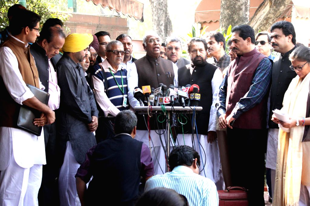 Opposition MPs including Congress leader Mallikarjun Kharge, Trinamool Congress leader Sudip Bandyopadhyay and others talk to press at the Parliament premises in New Delhi on Dec 4, 2014.
