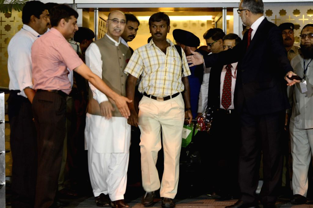 Pakistan High Commissioner in India Abdul Basit welcomes Indians evacuated by Pakistan Navy from violence-hit Yemen as they arrive at the IGI Airport, in New Delhi on April 8, 2015.