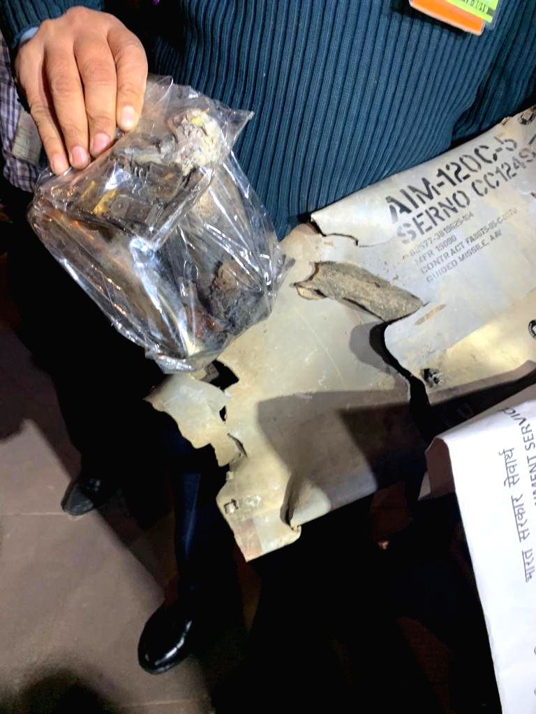 New Delhi: Parts of AIM 120 AM-RAAM missile that were found on the Indian side, being shown to the media persons during a press conference in New Delhi on Feb 28, 2019. (Photo: IANS)