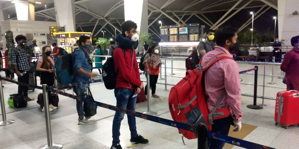 New Delhi: Passengers follow social distancing norms at they enter Indira Gandhi International Airport via Terminal 3 after India resumed civil passenger flight services on Monday, exactly two-months after it had suspended these operations due to the