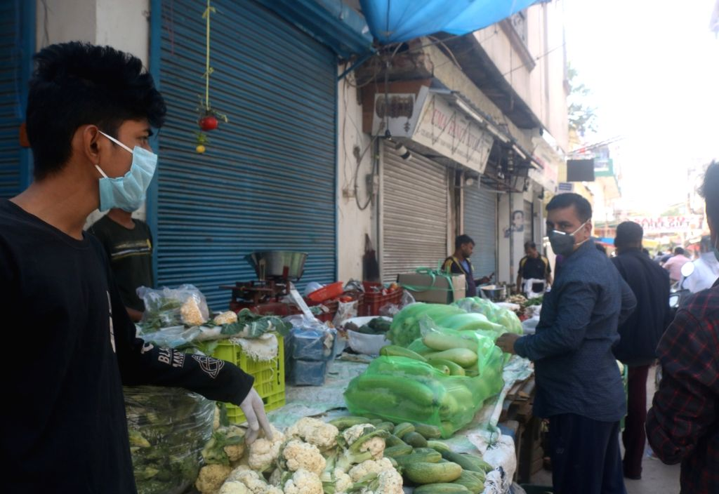 New Delhi: People busy purchasing vegetables during complete lockdown in the country in a bid to curtail the spread of coronavirus, in New Delhi on March 23, 2020. (Photo: IANS)