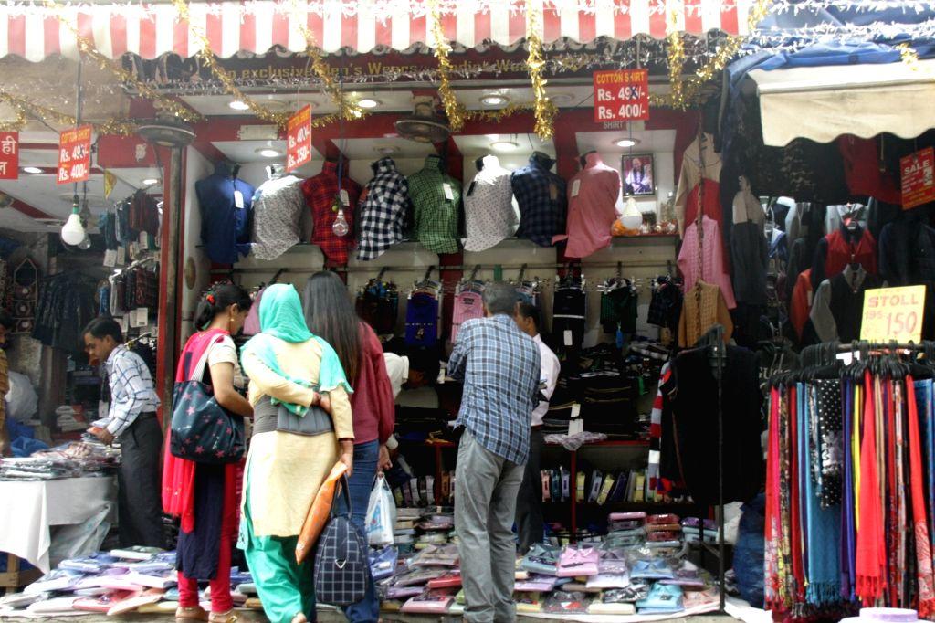 New Delhi: People busy shopping ahead of Diwali, at a market in New Delhi on Nov 5, 2018. (Photo: IANS)