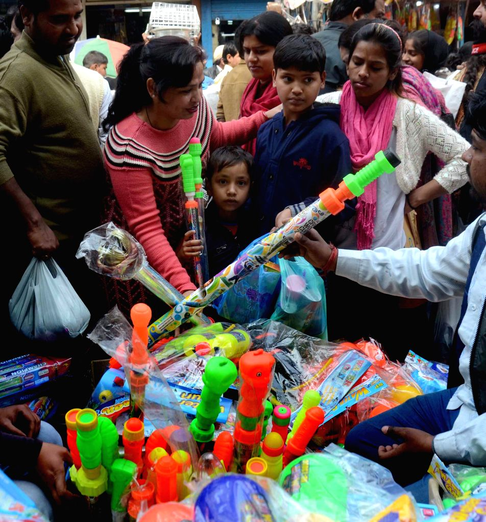 People busy with Holi shopping at Sadar Bazar of New Delhi on March 3, 2015.