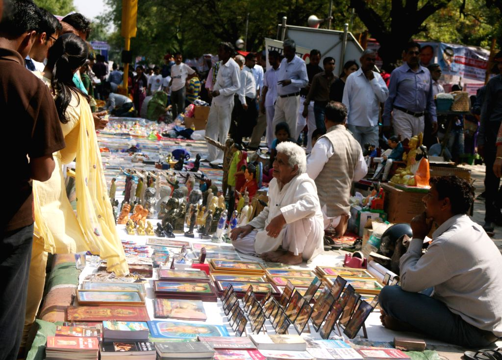 People busy with shopping on the B R Ambedkar`s 124th birth anniversary at Connaught Place in New Delhi on April 14, 2015.