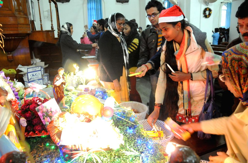 People celebrate Christmas at a Delhi church on Dec 25, 2014.