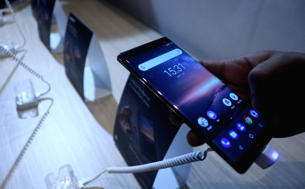 :New Delhi: People check out the features of newly launched Nokia 6, 7 Plus and 8 Sirocco smartphones during a launch programme in New Delhi on April 4, 2018. (Photo: IANS).