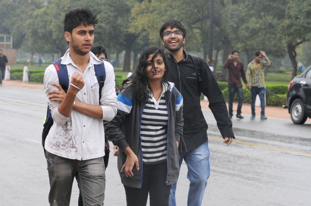 People enjoy themselves during rains in New Delhi, on March 1, 2015.